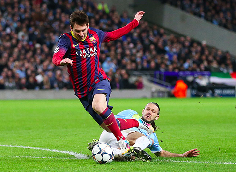 Man City trips Messi in Champs League